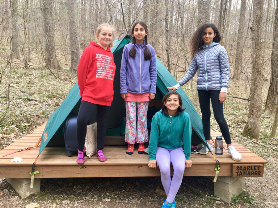 girls by tent at outdoor lab