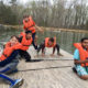 boys on raft at outdoor lab